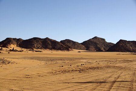 Trail in Libyan desert photo