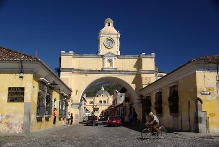 corner clock: Street in Antigua, Guatemala Editorial