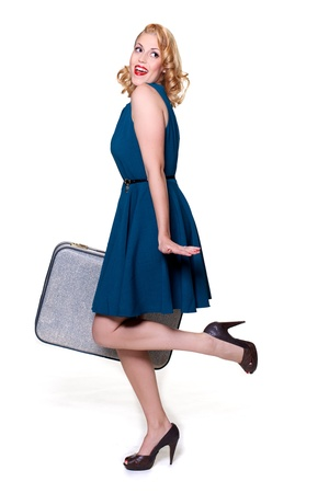 Woman with suitcase looking back photo