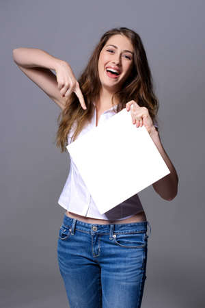 Laughing woman is showing on a billboard Stock Photo - 17057002