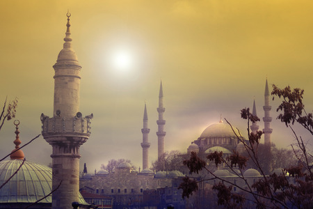The sun sets behind the Suleymaniye Mosque in Istanbul