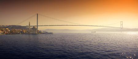 A romantic sunrise over the first intercontinental bridge of Bosporus in Istanbul Stok Fotoğraf