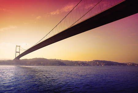 A romantic sunset over the first intercontinental bridge of Bosporus in Istanbul Stok Fotoğraf