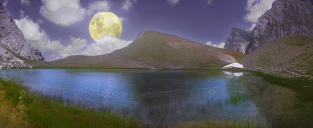 Full moon over the magnificent Dragon Lake at an altitude of 2000 meters in Pindus mountain range - Greece