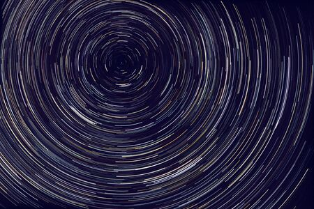 star trails -  light streaks of stars around Polaris in the night sky due to Earths rotation
