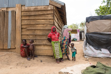 Women outside the wooden makeshift place of Internally Displaced Persons in Abuja, the Federal Capital of Nigeria.