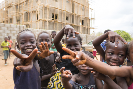 Children living in the wooden makeshift place of Internally Displaced Persons in Abuja, the Federal Capital of Nigeria. Редакционное