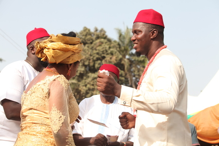Husband and wife dances after receiving marriage blessings to the delight of everyone as people congratulate them.
