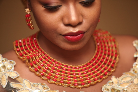 African bride dresses up in third attire of the day to go identify her groom and bring him to her family for marriage blessings. Stock fotó