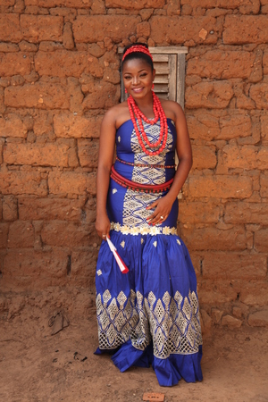 African bride poses for picture before going out to welcome the family of the groom on her traditional wedding day.