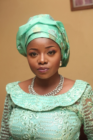 A beautiful African girl dressed in traditional attire on her native wedding day.