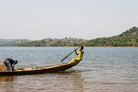 Two young fishermen setting off to a fishing expedition.