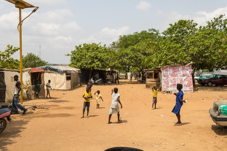 Children playing outside Wooden makeshift place of Internally Displaced Persons in Abuja, the Federal Capital of Nigeria.