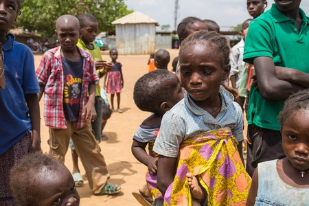 A little girl taking care of a baby and living in the wooden makeshift place of Internally Displaced Persons in Abuja, the Federal Capital of Nigeria.