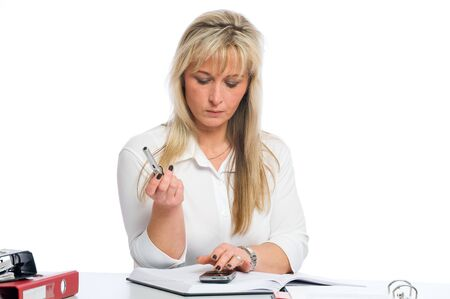 scheduling system: young blond businesswoman is planning dates Stock Photo