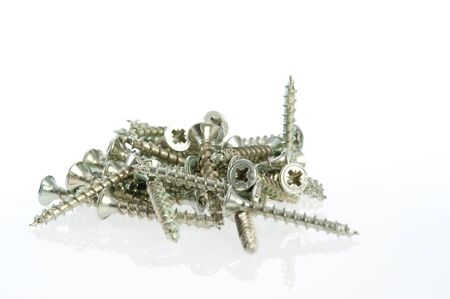 Close-up of screws on a white background