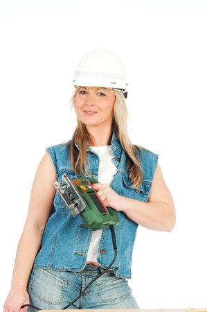 Young blonde woman is working with Jigsaw photo