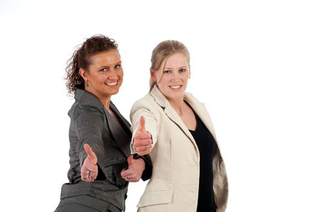 office force: Two young business women show the thumbs -