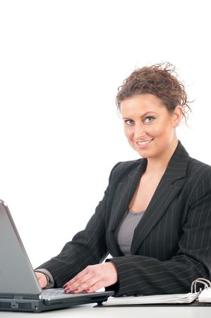 office force: Young business woman working in office with laptop