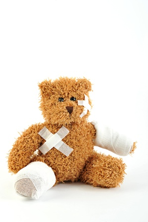 health insurance: sick teddy bear on white background