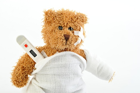 sick teddy bear on white background