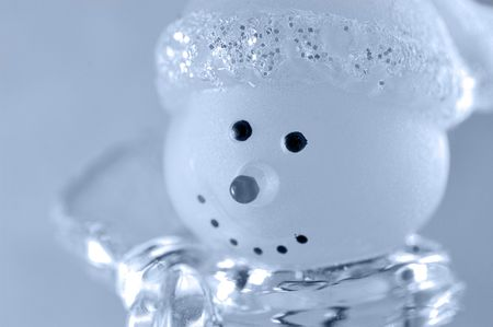 greets: A glass snow man in a fur-cap greets us