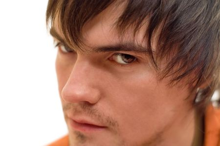 malcontent: A portrait of a young brunet with angry glare