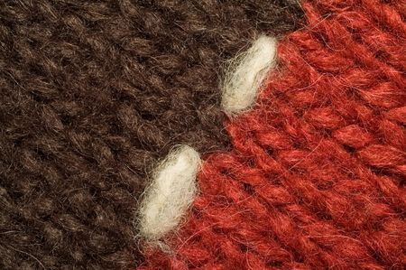 woolen cloth: Two halves of red and black woolen cloth