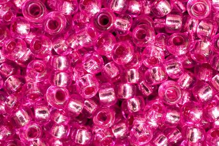 reverberate: Pink beads macro background