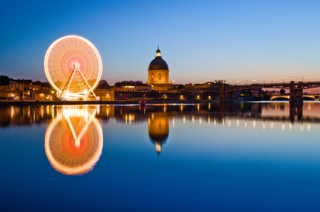 Big wheel in the evening in Toulouse city ancient center Stock Photo
