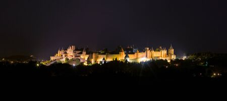 impregnable: Carcassonne castle  France  at night, view from highway Editorial
