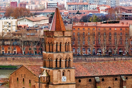 nicolas: Saint Nicolas V-th century church on Toulouse city center and Garonne river background, France