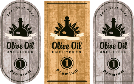 set of labels for olive oils on the background of wood texture
