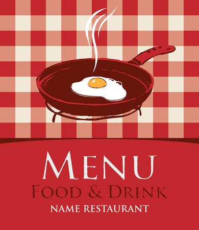 huevos fritos: men� con una sart�n y los huevos fritos en el fondo de un mantel a cuadros