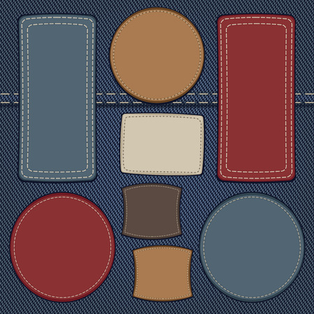 leather pants: set of leather labels on denim background