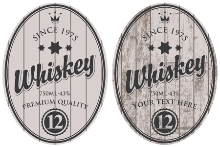 gray: Set of two oval labels for whiskey on a gray wooden background with calligraphic inscription, crown and stars.