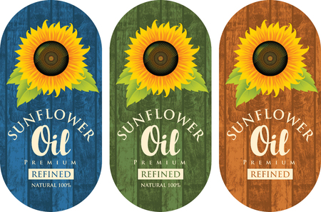 Set of three vector labels for refined sunflower oil with sunflower and the inscription on the wooden background of different colors Ilustração