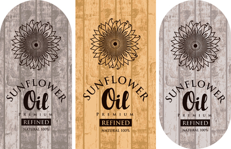 Set of three   labels for refined sunflower oil with sunflowers and inscriptions on wooden
