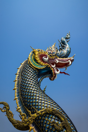 The naga statue on blue sky background in thailand.