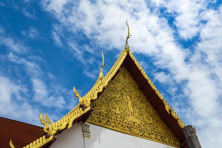 Gable apex on blue sky background, temple thailand