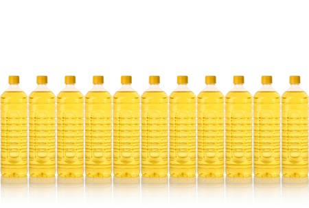 cooking oil bottle in a row isolated on white photo