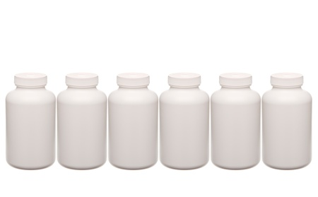white pills containers in a row isolated on white photo