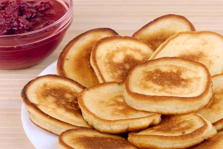 rubicund: heap of pancakes with bowl of strawberry jam Stock Photo