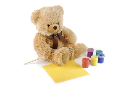 Teddy bear painting colors isolated on white photo