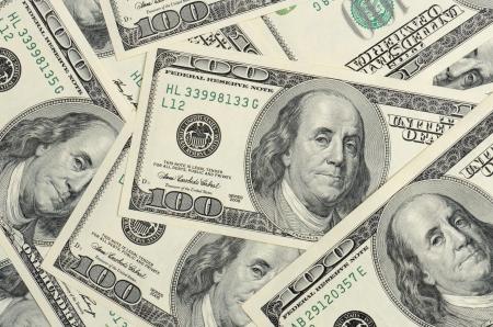 달러: 백 달러 지폐의 배경을 닫습니다