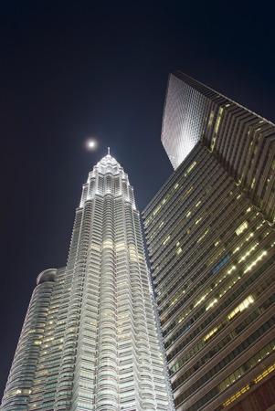 petronas: night skyscraper Petronas and the moon