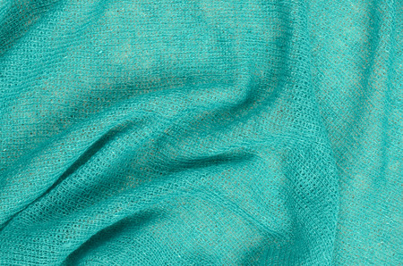 celadon green: close up blue scarf background