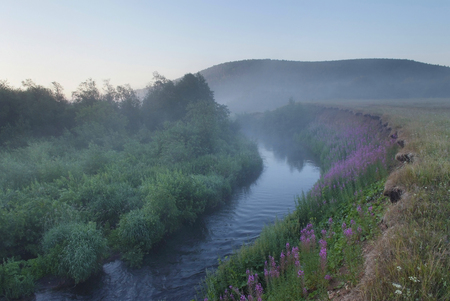 misty morning on the river in the foothills of the Urals Stock Photo