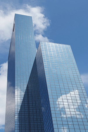modern skyscrapers in Rotterdam with reflections of clouds