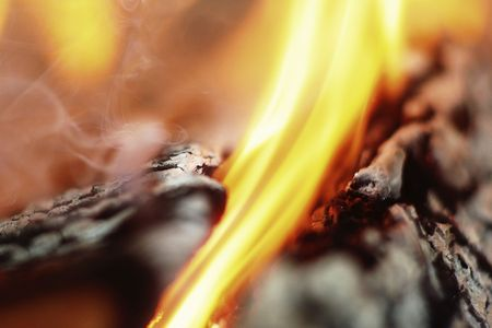 chimney corner: Macro burning and smoked fire woods. Shallow depth of field.